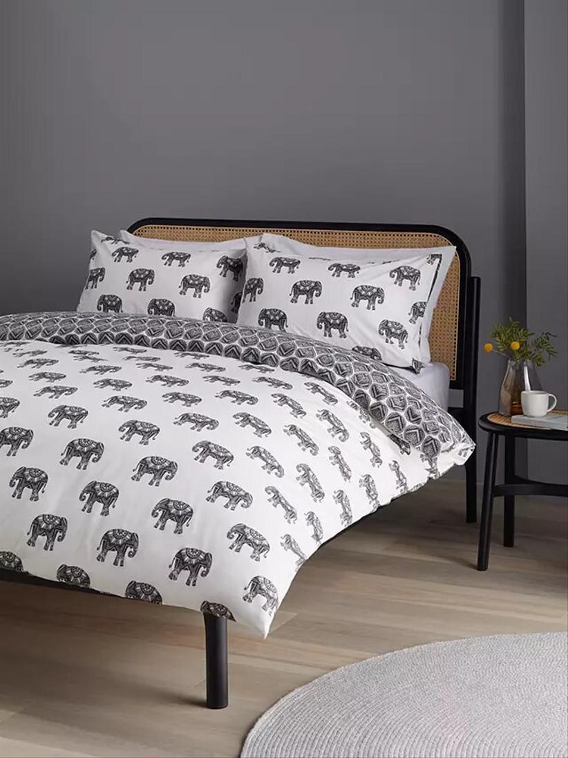 Elephant print duvet set on a bed