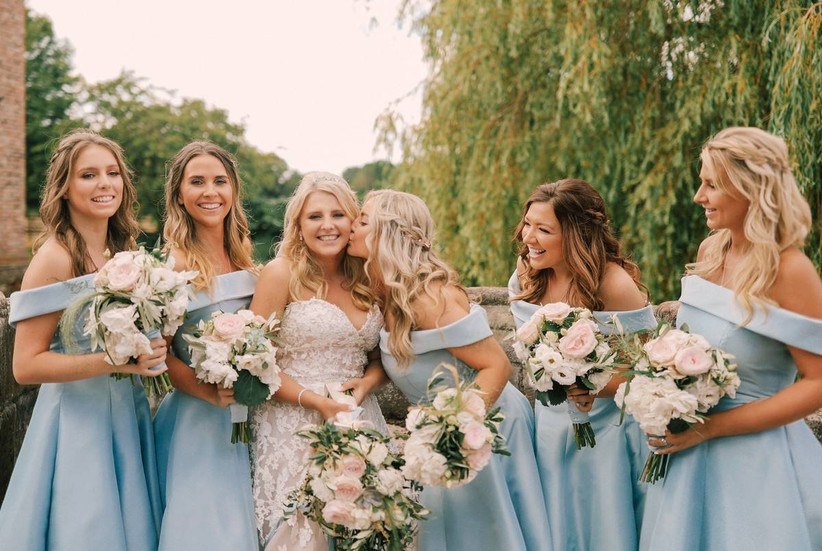 Bridesmaids and a bride with half up half down hairstyles