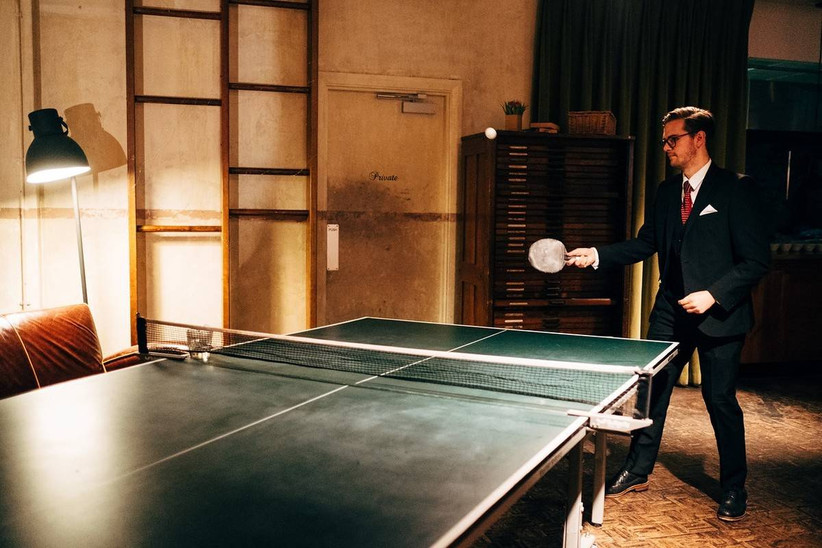 Wedding guest playing table tennis
