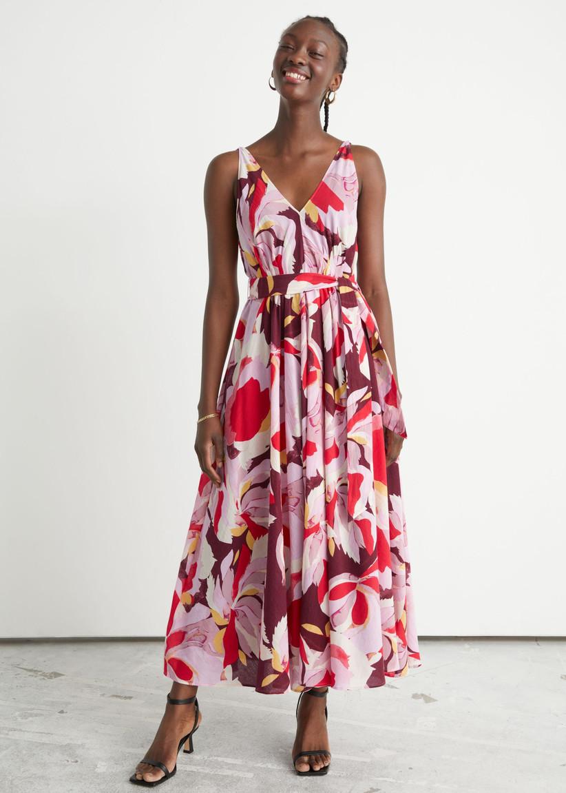 Model wearing a patterned wedding guest dress