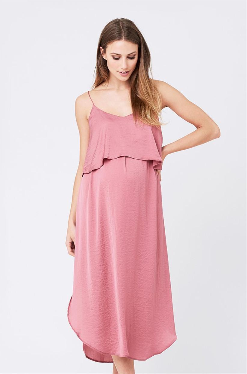Model wearing a pink midi slip dress