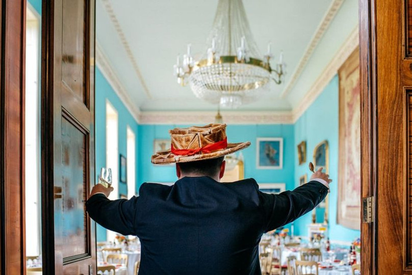 man wearing hat made of toast