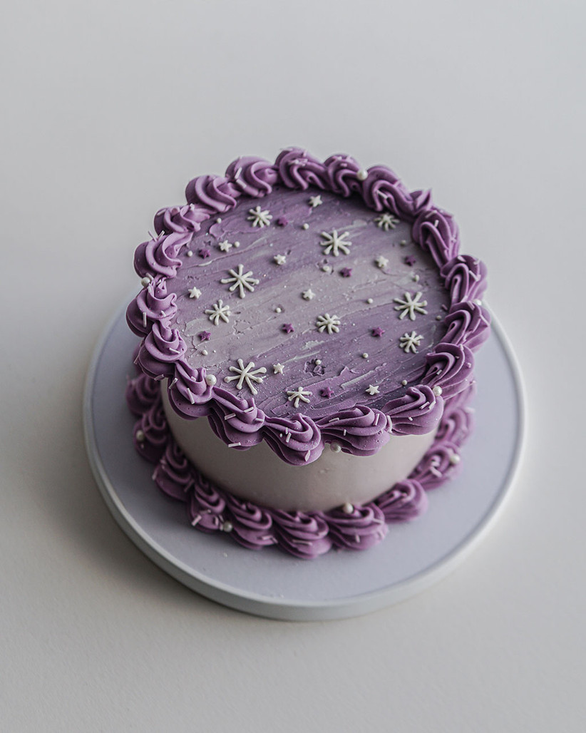 Purple celestial cake with piping