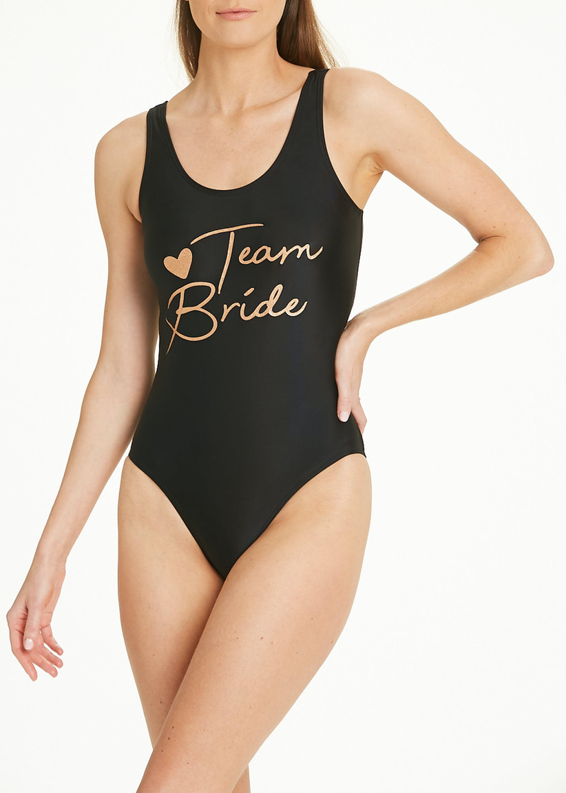 black swimming costume with Team Bride written on it