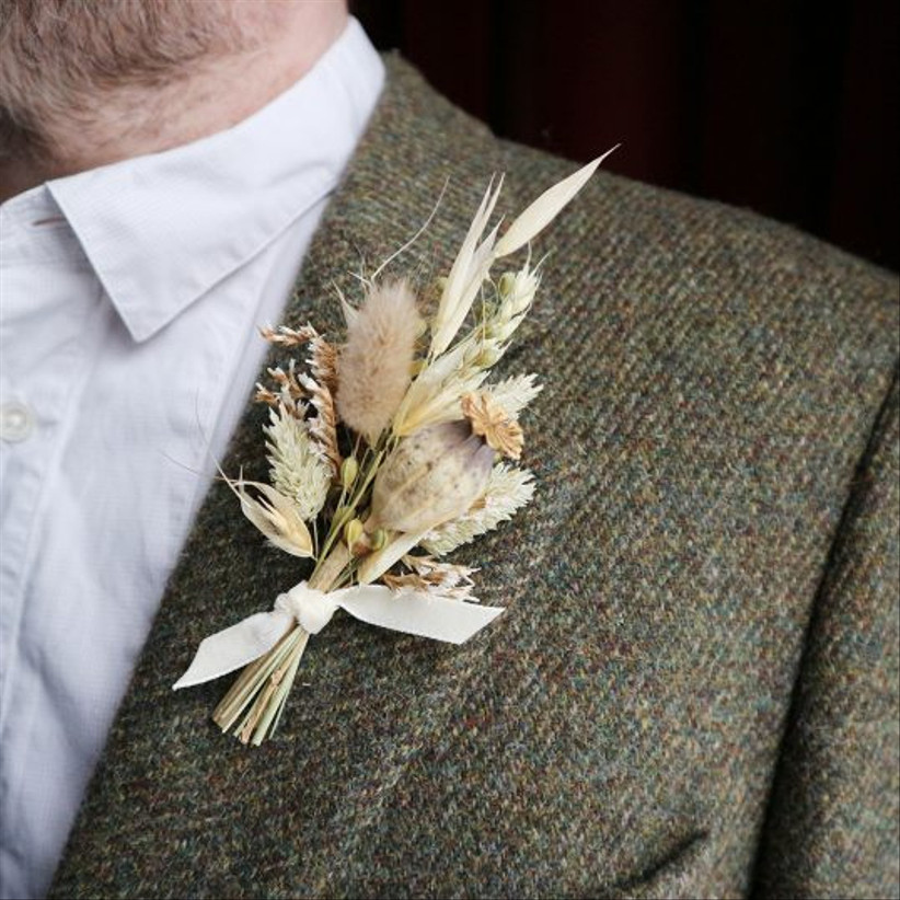 Groom wearing a dried floral wedding buttonhole