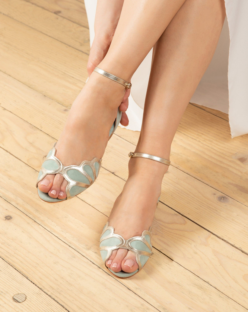 Model wearing mint a gold shoes