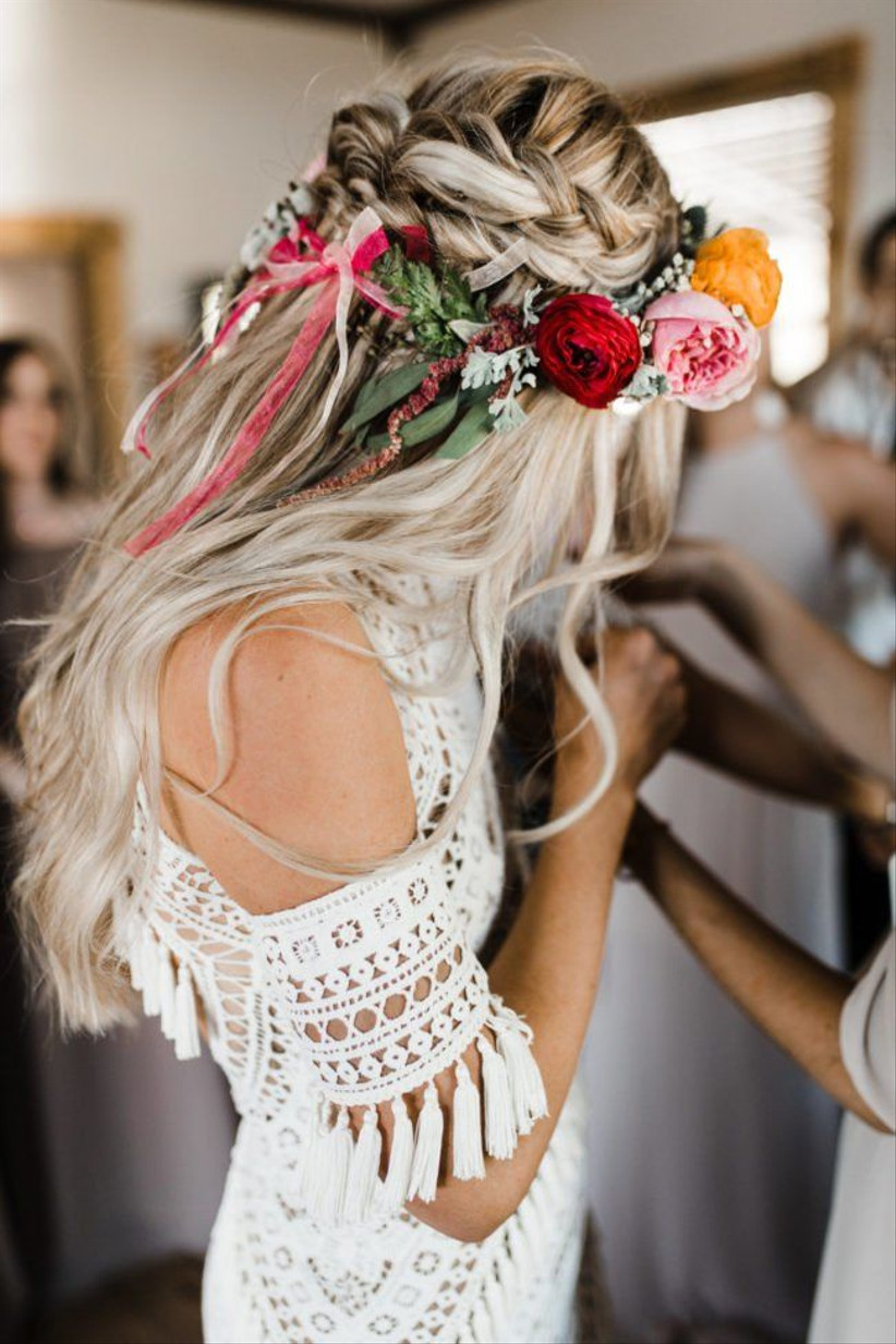 Model with a bright floral hairband with ribbons