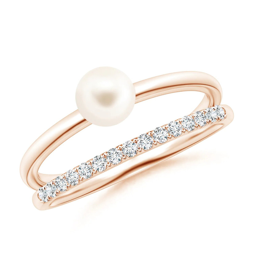Pearl and diamond rose gold engagement ring