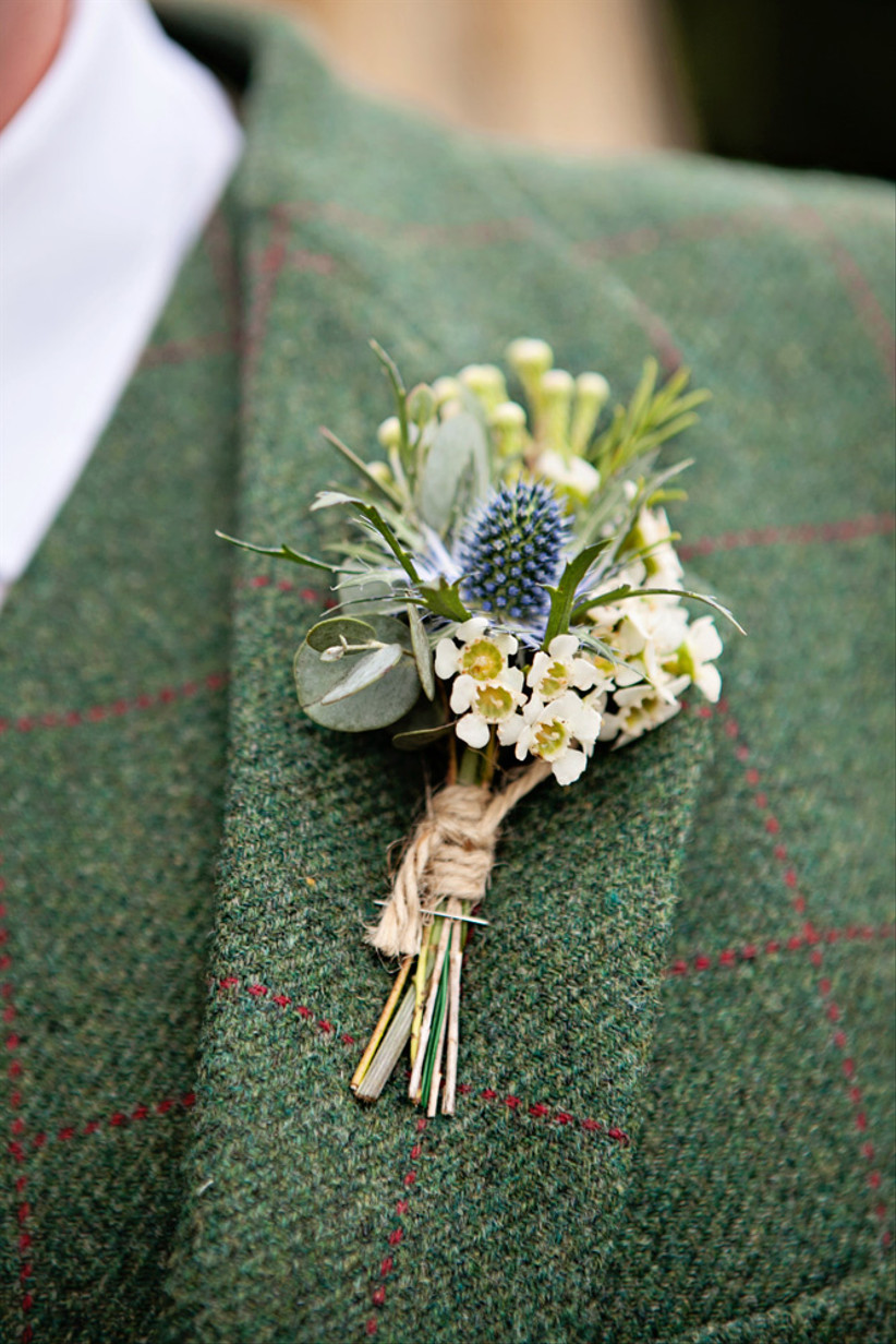 Groom wearing a thistle wedding buttonhole
