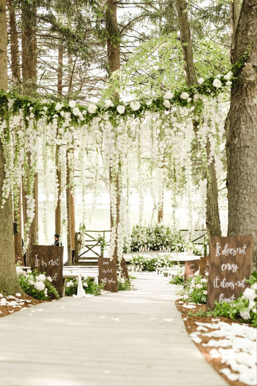 White wisteria hanging at a wedding ceremony