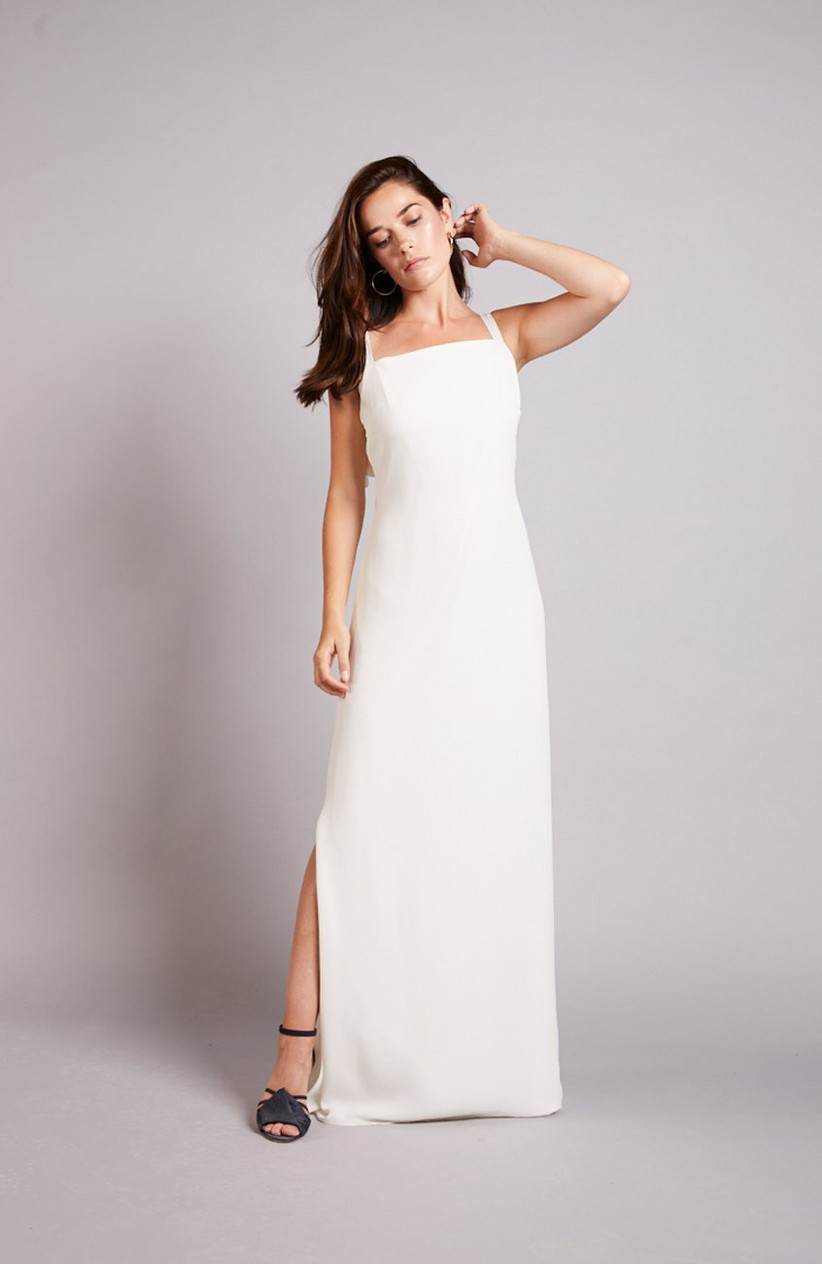 Model wearing a square necked white bridesmaid dress