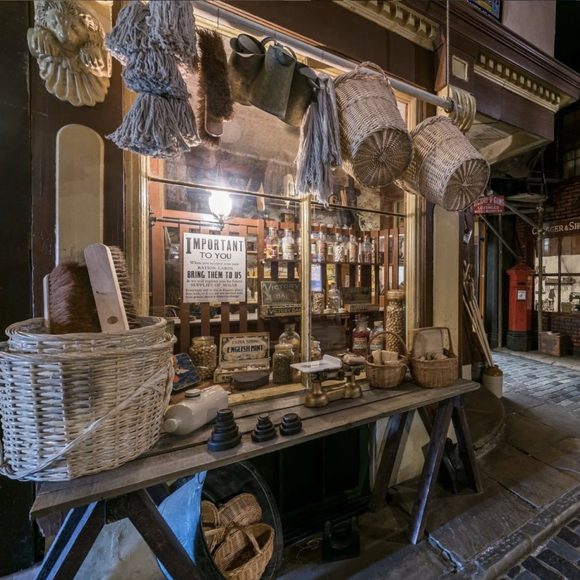 Victorian general store on a cobbled street at nightfall
