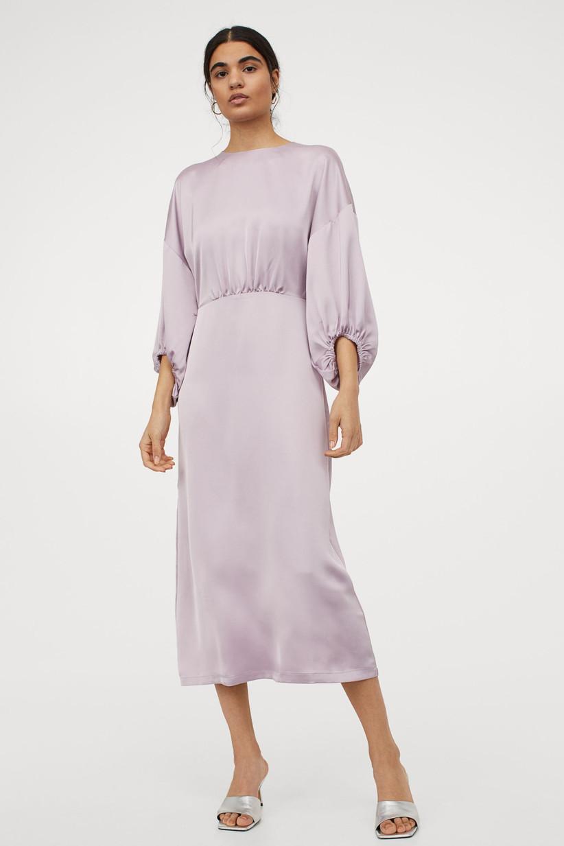 Model wearing a satin midi dress in lilac