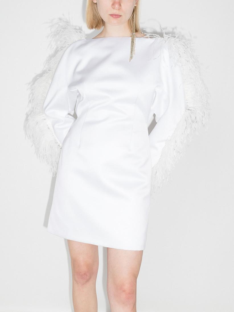 Model wearing a feather sleeve wedding dress