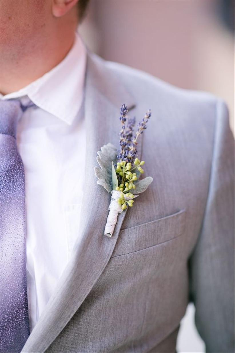 Groom wearing a lavender wedding buttonhole