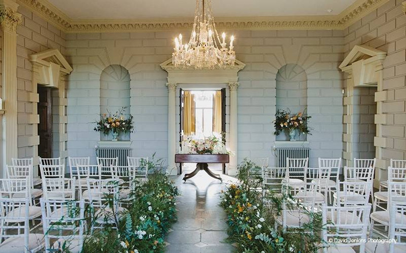 White brick walled wedding ceremony area