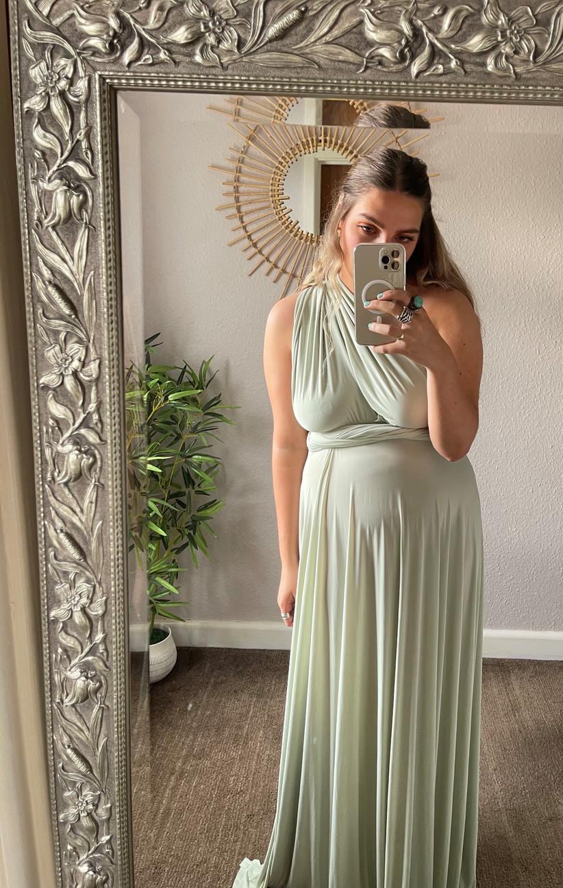 Model wearing a green maxi bridesmaid dress