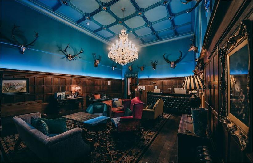 Castle wedding venue living area with deer heads