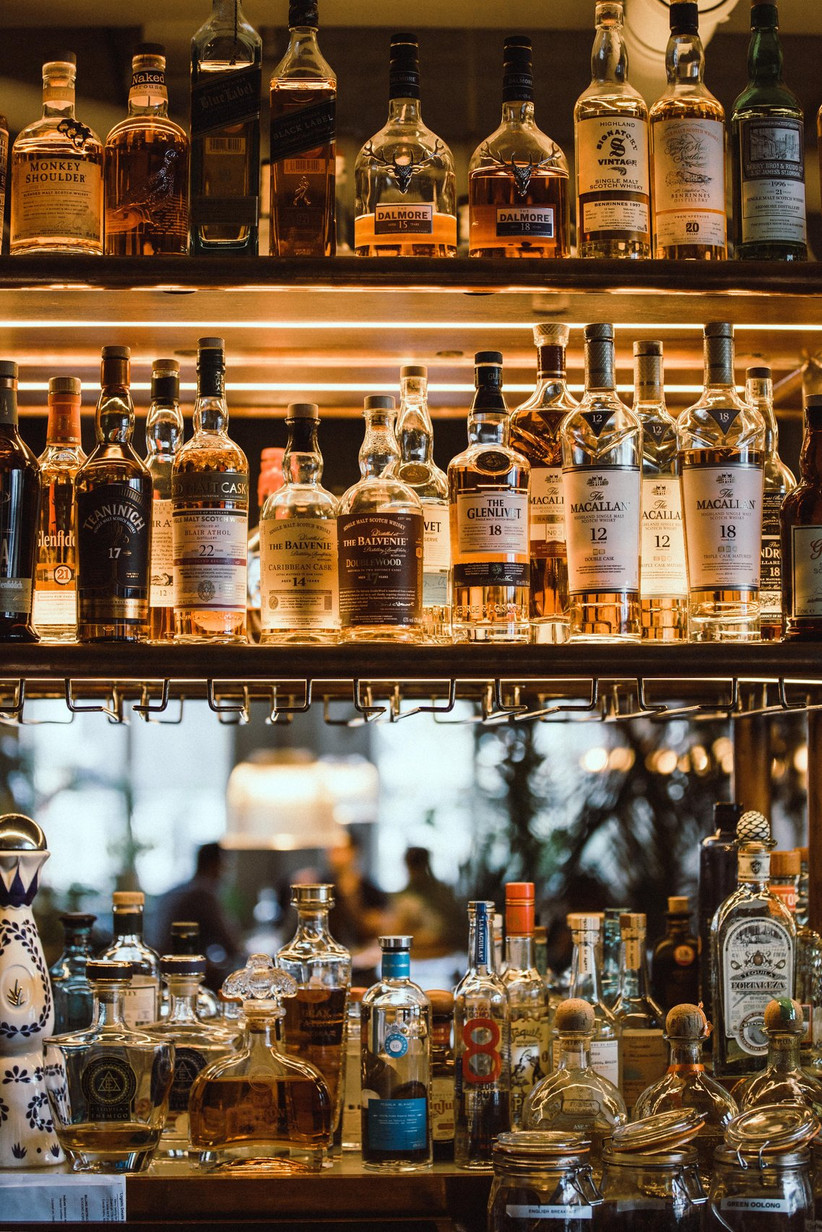 Mirrored bar lined with spirits and tea in kilner jars