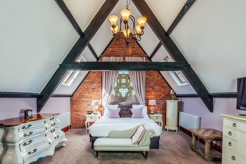 Bedroom in a church with stain glass windows