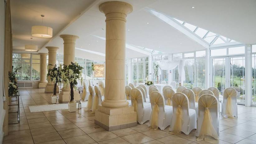 White decorated wedding ceremony room