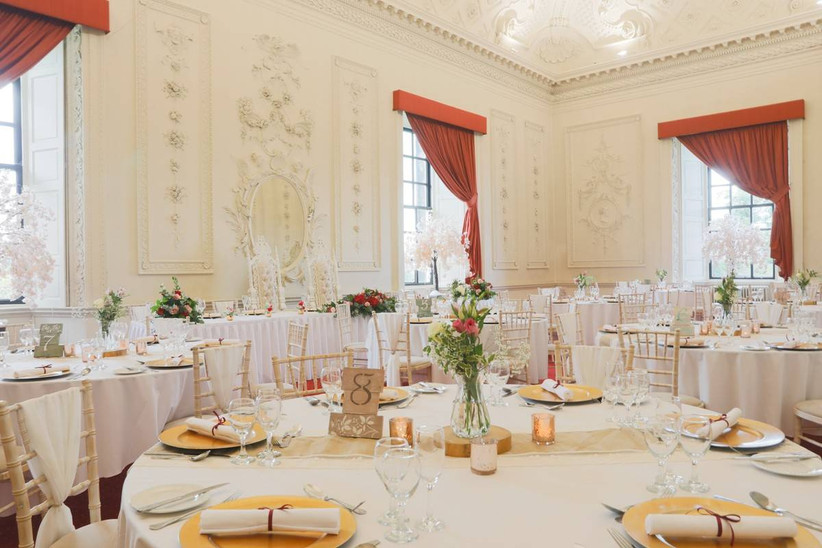 Wedding dining area with red curtains and white walls