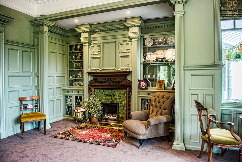 Dining room with green walls at Douneside House