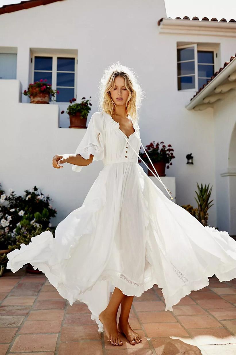 Model in a flowy beach wedding dress