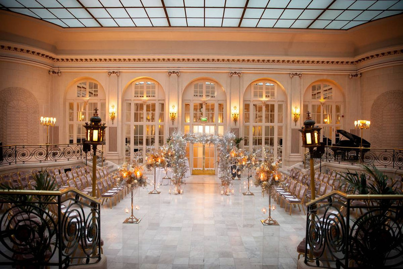 Wedding ceremony area with large glass windows