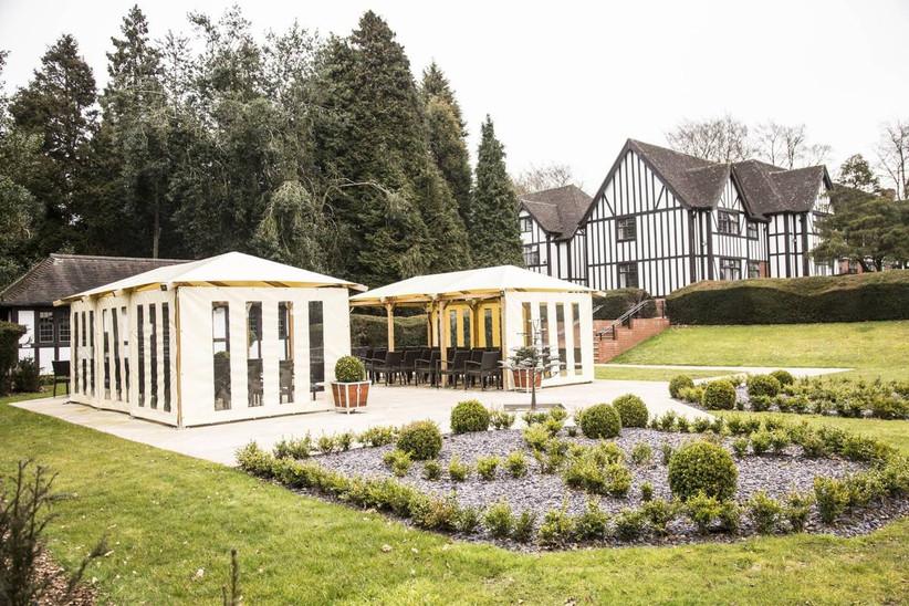 Tudor style manor wedding venue with outdoor ceremony space