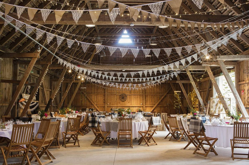 Rustic barn dining area with bunting
