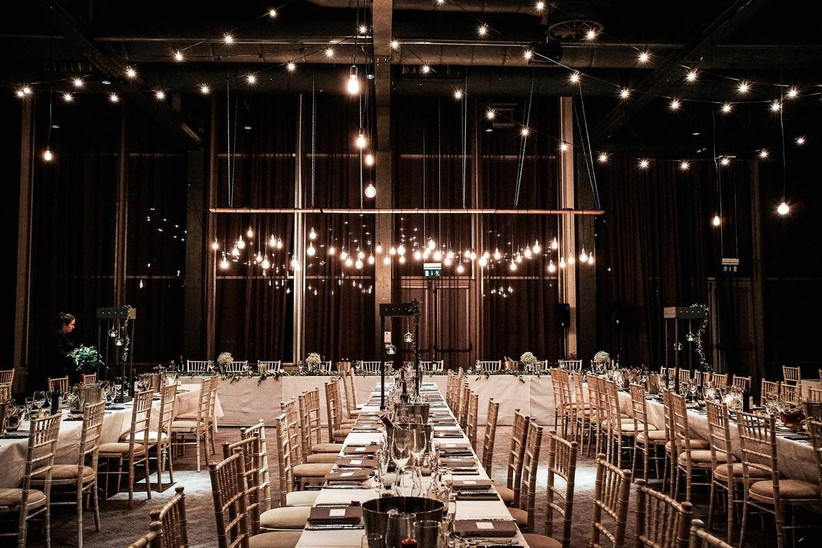 Dining area at a wedding reception decorated with fairy lights