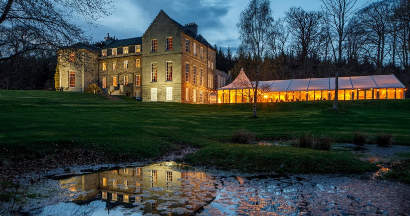 Exterior of Raemoir House and lit-up marquee at night