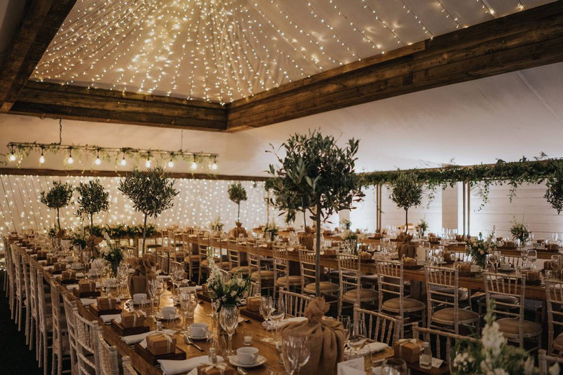 Wedding dining tables in a barn