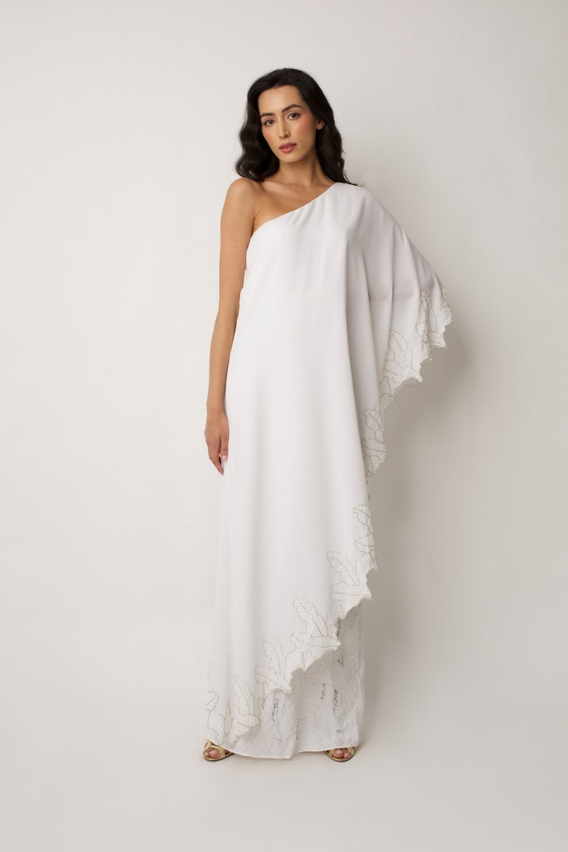 Model in a one sleeved cape wedding dress