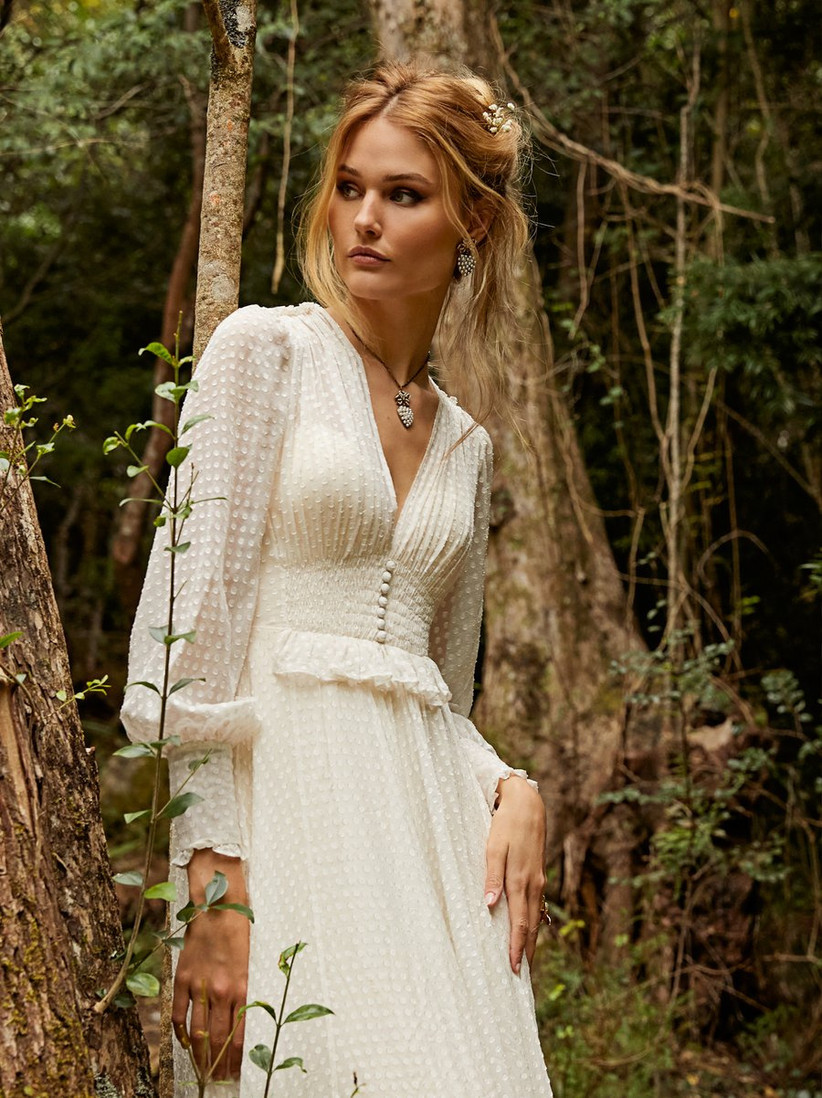 Model in a dotted silk long sleeved wedding dress