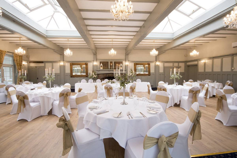 Wedding dining area with candlesticks