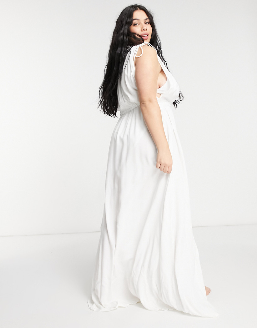 Model wearing a white floaty bridesmaid dress