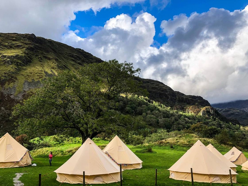 Glamping tents in the rolling countryside