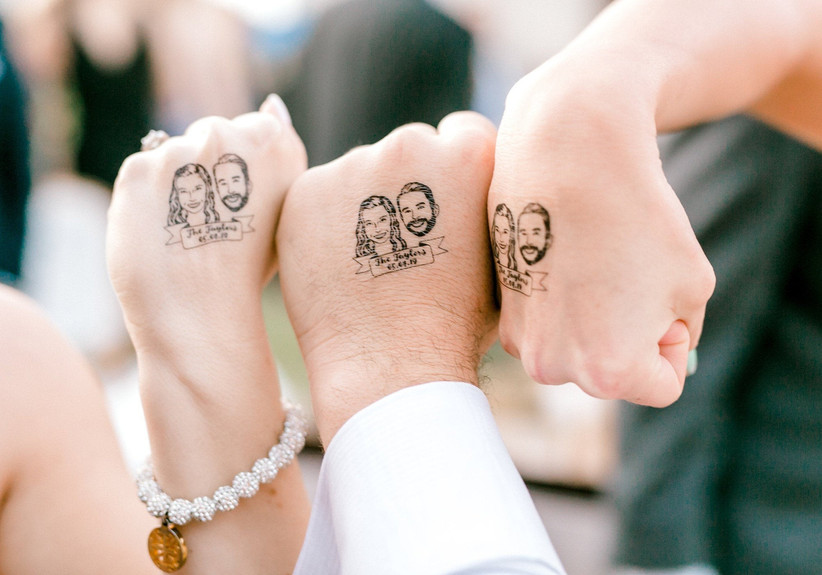 Hands with face wedding tattoos