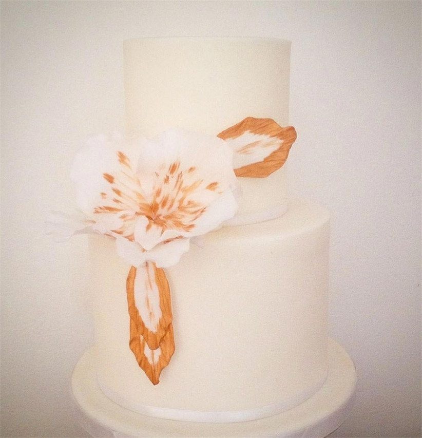 white-wedding-cake-with-rose-gold-floral-detail