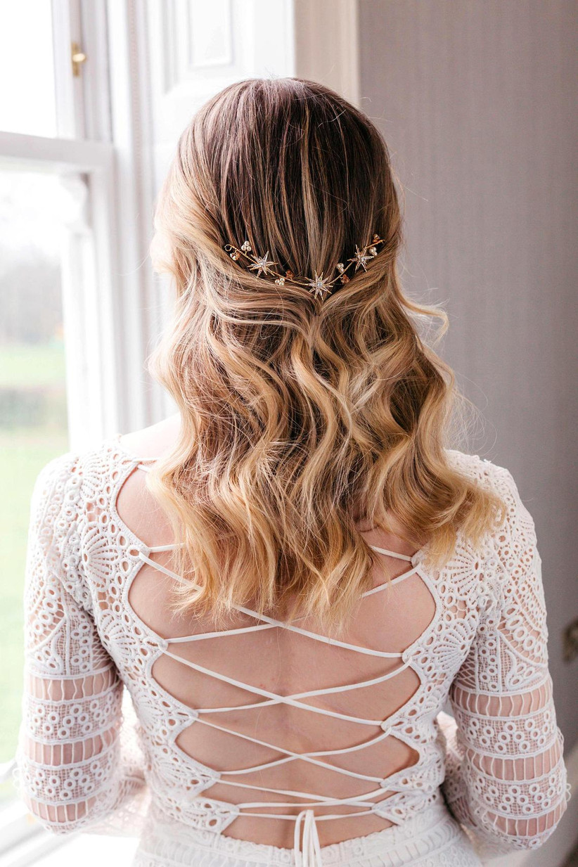 Barely there half up half down hairstyle with star hair piece
