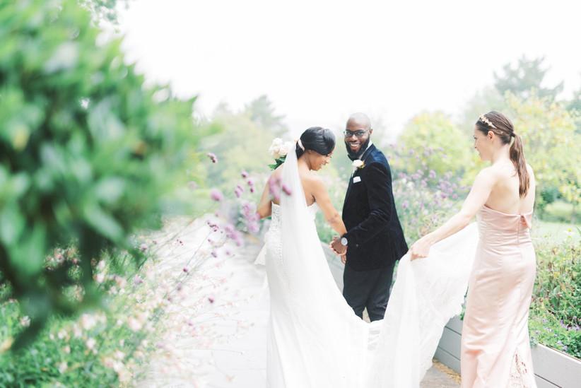 Bridesmaid holding the bride's train