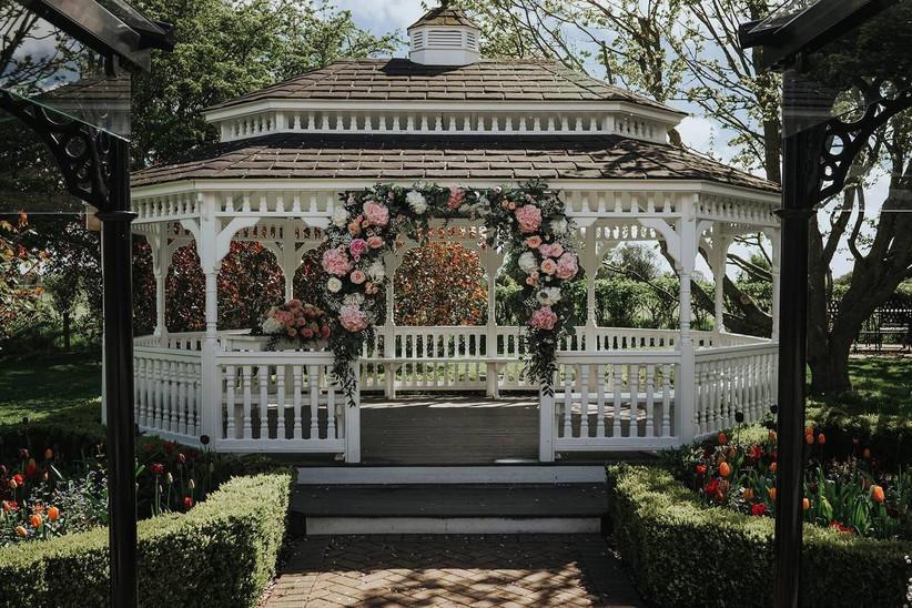 Garden gazebo with a pink rose arch