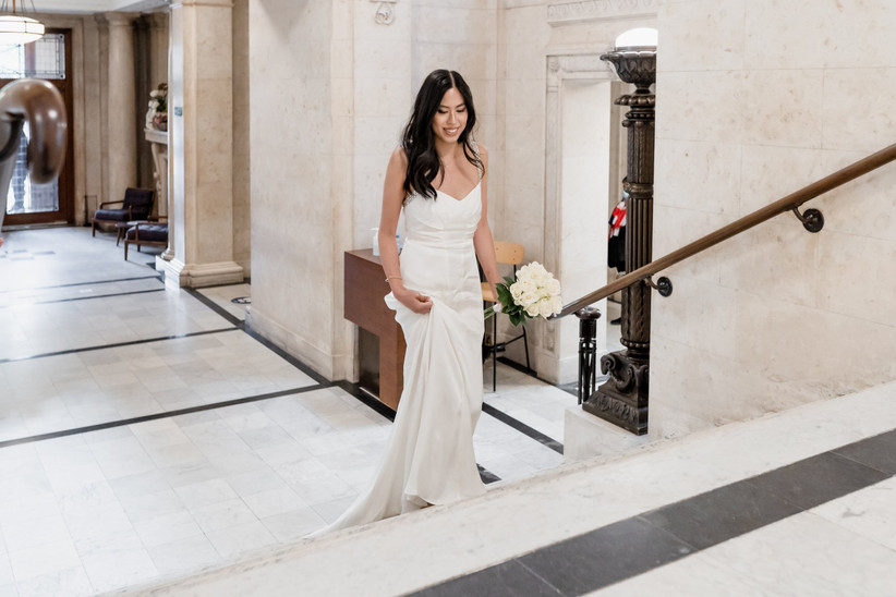 Bride walking up stairs to wedding ceremony