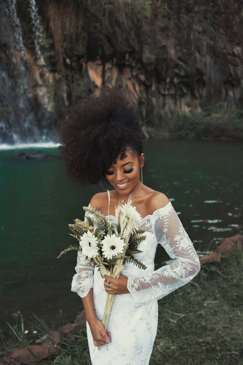 A bride posing with a bouquet