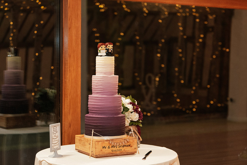 The wedding cake, which is three tiers in purple ombre