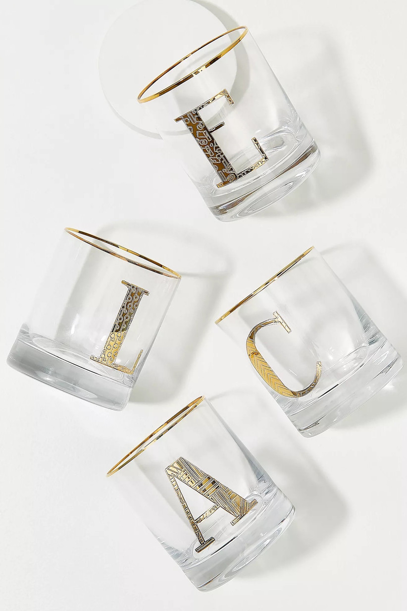 Collection of clear tumblers with different letters etched on in gold