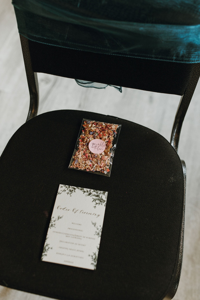 Confetti and the order of the ceremony on a chair