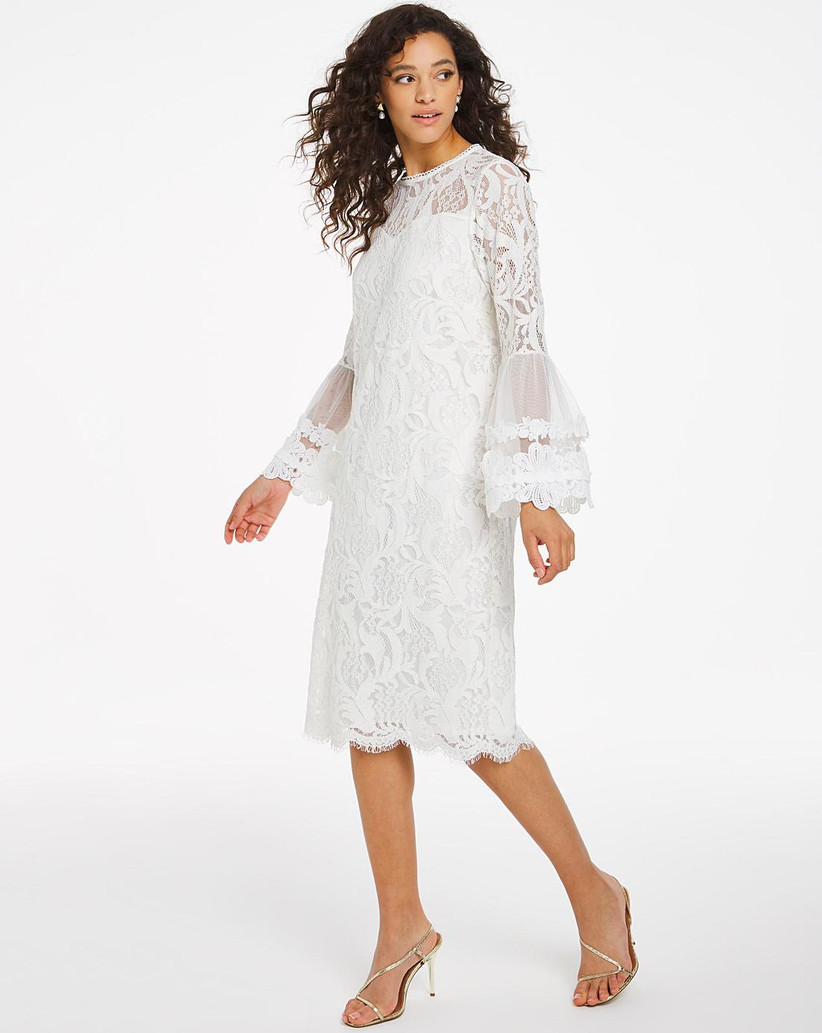 Dress wearing a lace midi wedding dress